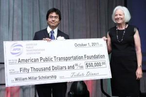 Kyle Taniguchi accepting the APTA scholarship check from Linda Bohlinger