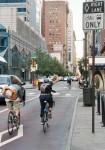 bicyclist riding on an urban street